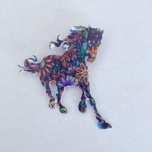 A horse brooch